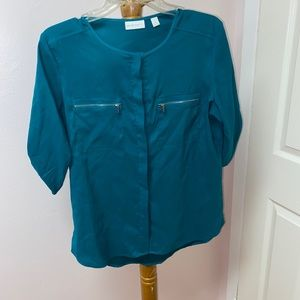 green blouse with super cute zipper front pockets